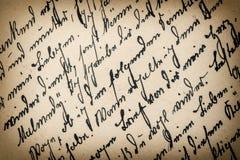 Antik handskrift med en text i odefinierat språk royaltyfria foton