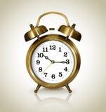 antik klockaguld för alarm Arkivfoton
