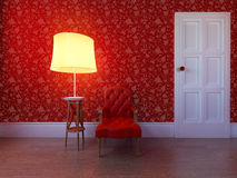 Antik läderstol mot en röd vägg Arkivfoton