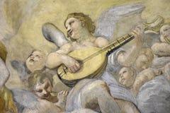 Antik målning inom en katolsk kyrka i mitten av Rome arkivbild