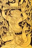 Antik målning på dörren i tempel i Thailand Arkivfoton