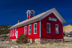 Antik Maysville skola, gammal röd skolhus, 1882-1939, Caffee län, förutom Salida, Colorado Royaltyfria Foton