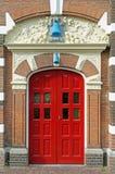 Antik röd dubbel dörr Arkivbild