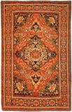 Antik röd persisk iransk matta Arkivfoto