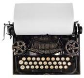 Antik skrivmaskin med det vita tomma arket av papper Fotografering för Bildbyråer