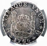Antik spansk silverdollar Arkivfoto