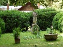 Antik staty i botaniska trädgården, Cluj-Napoca Royaltyfri Foto