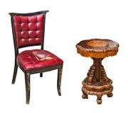 Antik tabell och stol Fotografering för Bildbyråer