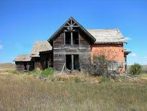 antik tegelsten dilapidated huset Arkivfoto