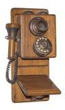 Antik trätelefon som isoleras arkivfoto