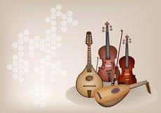 Antika musikinstrumentrader på brun etapp  Royaltyfri Bild