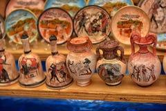 Antika till salu vassouvenir Arkivbilder