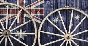 Antika vagnhjul med den Australien flaggan Royaltyfria Bilder