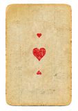 Antike benutzte Spielkarteherz-as Papierhintergrund mit drei Symbolen Lizenzfreies Stockfoto