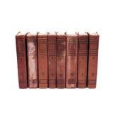 Antike Bucheinbänd auf weißem Hintergrund acht Volumen der antiken Bücher mit Zahlen von 1 bis 8 Seltene Sammlung Lizenzfreie Stockbilder