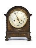 Antike hölzerne Uhr auf weißem Hintergrund Stockbilder