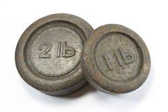 Antike Küchen-Gewichte 1lb und 2lb Stockfotografie