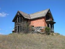 Antike verfiel Ziegelstein-Haus Stockfotografie