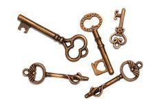 Antiker Skeleton Vorhängeschloss-Bronzeschlüssel stockfotos