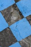 Antiker Steinboden gemalt im schwarzen und blauen Mosaik Hintergrund Stockfoto