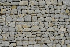 antiker Steinwandhintergrund Lizenzfreies Stockfoto