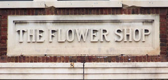 Antikes Blumenladenzeichen Stockfotografie