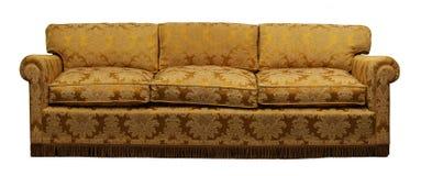 Antikes gelbes Sofa auf weißem Hintergrund Stockfotografie