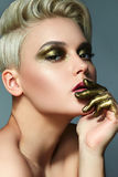 Antikes Gold des Makes-up lizenzfreie stockfotos