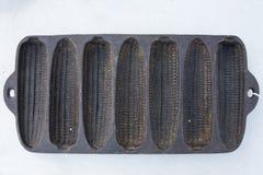 Antikes Roheisen-Mais-Brot Pan Lizenzfreie Stockfotos