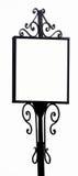 Antikes Schmiedeeisen Zeichen für Anzeigen mit einem weißen Hintergrund Stockbild
