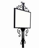 Antikes Schmiedeeisen Zeichen für Anzeigen mit einem weißen Hintergrund Lizenzfreie Stockfotografie