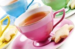 antikviteten cups tea fyra arkivbilder