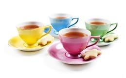 antikviteten cups tea fyra arkivfoto