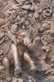 Antikviteten kriger elefantstatyn på väggen royaltyfri fotografi