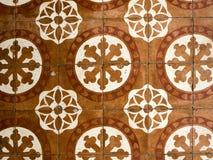 antikviteten planlägger golvtegelplattor royaltyfria foton