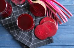 Antioxidant beet smoothies and sliced beetroot. On wooden table Royalty Free Stock Photo