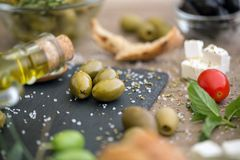 Antioxidant healthy green olives in black plate. Background Royalty Free Stock Photography