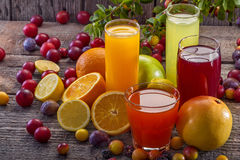 Antioxidant juices. Of citrus, apple, plum and blackberry royalty free stock photo