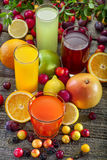 Antioxidant juices. Of citrus, apple, plum and blackberry stock images