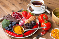 Antioxidant meal. Wooden table filled with antioxidant drinks and food stock image