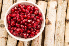 Antioxidant pomegranate seeds. Small bowl filled with ruby red antioxidant pomegranate seeds stock images