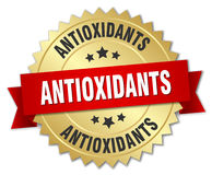Antioxidants 3d gold badge. With red ribbon Royalty Free Stock Photography
