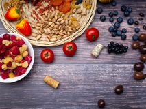 Resveratrol rich food on wooden surface, antioxidants, decorated with wine corks. Antioxidants, resveratrol food as grape, blueberry, strawberry, tomatoes stock photography
