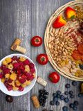 Resveratrol rich food on wooden surface, antioxidants, decorated with wine corks. Antioxidants, resveratrol food as grape, blueberry, strawberry, tomatoes stock image