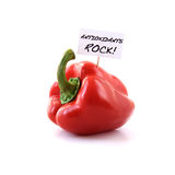 Antioxidants Rock!. Studio image of a red bell pepper with a positive antioxidant message. Possible cancer awareness campaign or healthy diet usage. Copy space royalty free stock photo