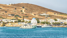 Antiparos port in Greece with a traditional white church standing in the middle. stock images