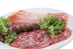 Antipasta. A selection of air-dried ham and spiced and herb- coated salami Stock Images