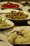 Antipasti. Buffet with plates full of fresh antipasti; focus on champignons Stock Photo