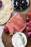Antipasti appetizer with grapes, olives, cheese and meat Royalty Free Stock Photo
