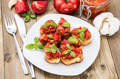 Antipasti (Bruschetta) on a plate Royalty Free Stock Photos